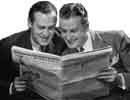 two guys reading newspaper